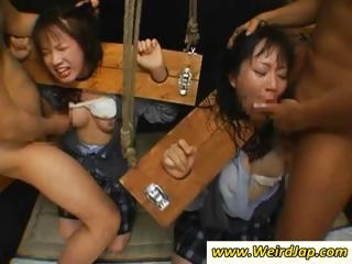 Asian slaves in be passed on stocks get their throats fucked relative to