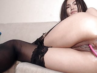Asian fucks her tight pussy coupled upon wet asshole upon hefty toy