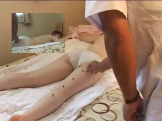 Skinny young Asian chick lays beyond the bed and gets a nice relaxing massage